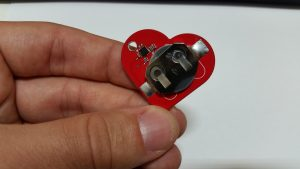 Back side of Heart Keychain in Hand