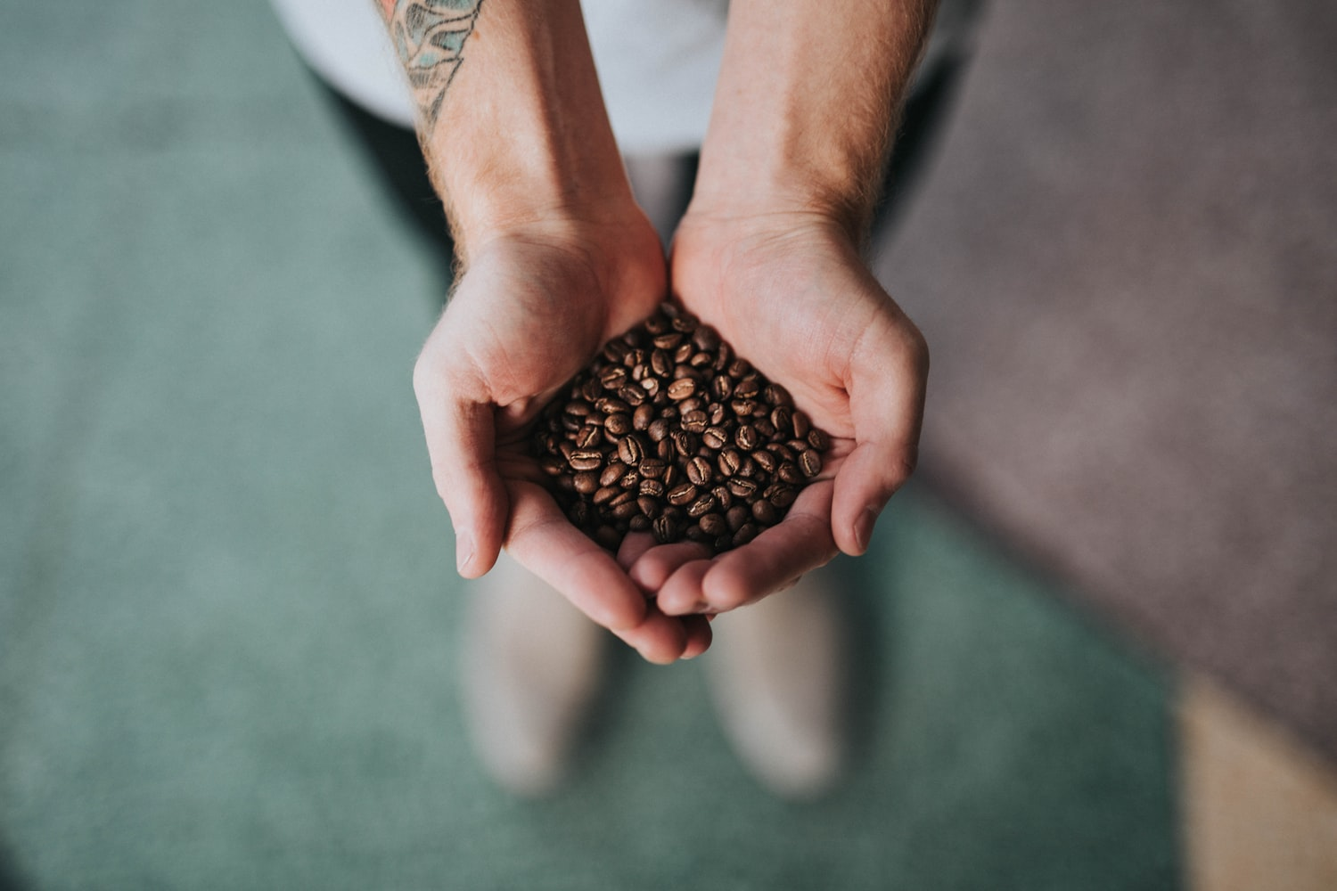 a handful of roasted coffee beans