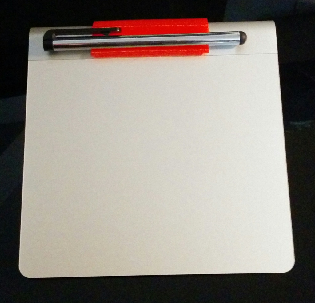 Pen holder on trackpad