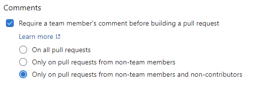 Require a team member's comment before building a pull request