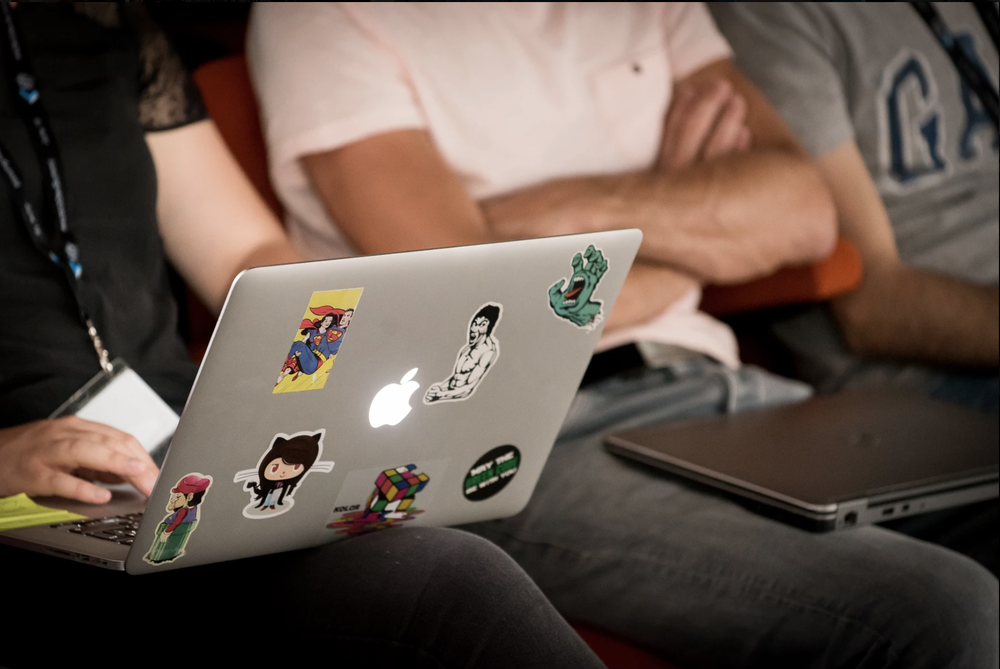 ADEO laptop with stickers