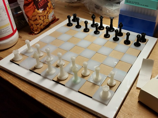 Image of 3d printed pieces, laser cut board