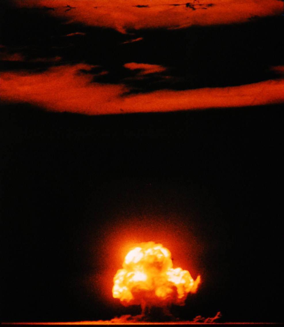 A fiery mushroom cloud lights up the sky