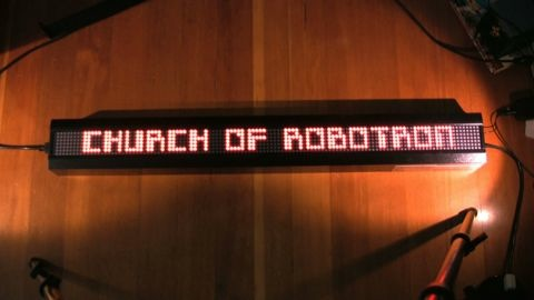 Readerboard running Church of Robotron