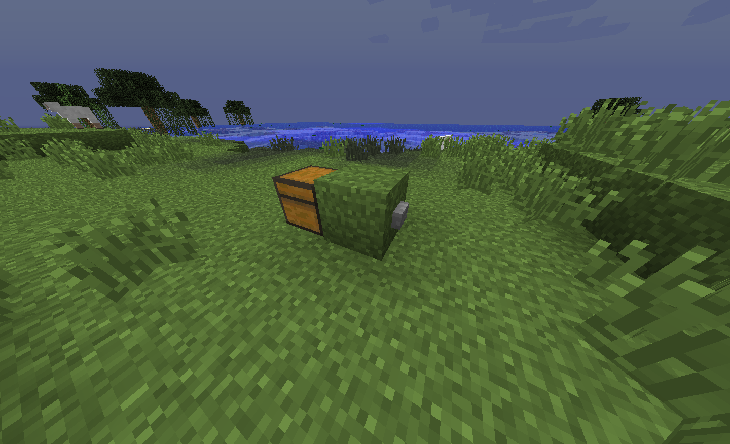 Image showing a button on a block behind a chest.