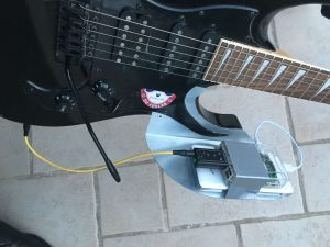 a rasp-effect mounted in a guitar